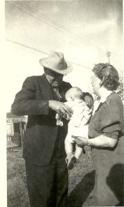 Buelle Everette Montrief and Mabel Montrief with grandson
